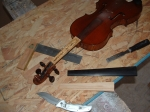 Glueing separated fingerboard on this violin. Adding handcrafted shim for angle correction avoiding expensive neck lift